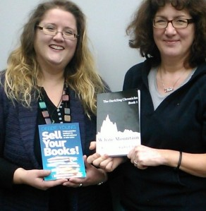 Sophie E Tallis and Debbie Young swap books
