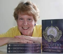 Alison Morton with paperback copies of Inceptio