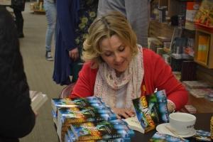 Isabel signing books instore