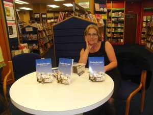 Photo of Bobbie Coelho at book signing table