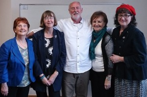 Photo of Debbie with four fellow authors at a reading